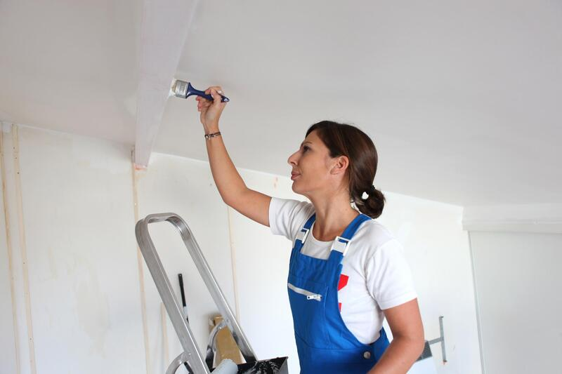 professional painter doing ceiling painting