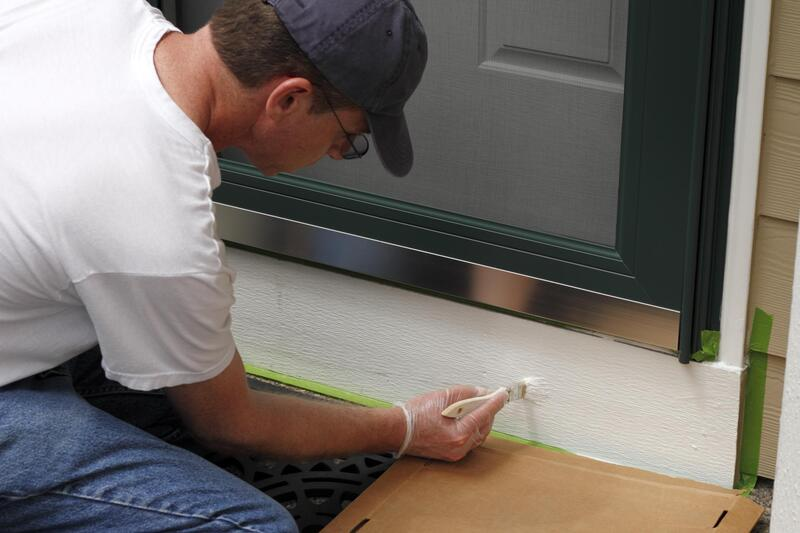 professional painter doing house painting
